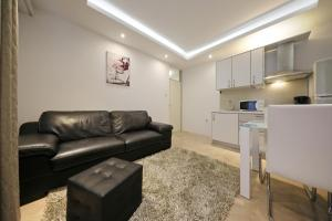 A seating area at Apartment Urban
