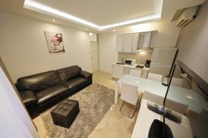 A kitchen or kitchenette at Apartment Urban