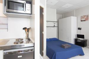 A kitchen or kitchenette at Résidence Carpe Diem
