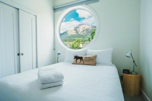 A bed or beds in a room at Basecamp Resorts Canmore