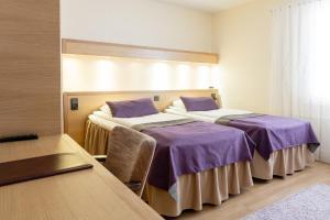 Säng eller sängar i ett rum på Samantta Hotel & Restaurant
