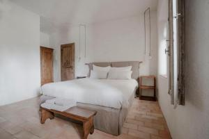 A bed or beds in a room at Agriturismo I Pini