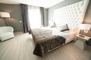 Letto o letti in una camera di National Park Hotel & Spa