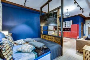 Кровать или кровати в номере Апартаменты Сити на Литейном