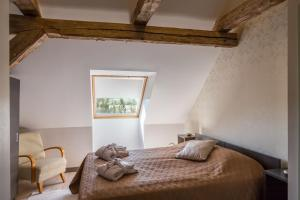 A bed or beds in a room at Dagen Haus Guesthouse