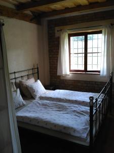 Postel nebo postele na pokoji v ubytování Penzion u sluníčka