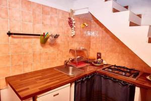 A kitchen or kitchenette at Borgo S.Maria Di Vulci