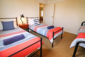 A bed or beds in a room at Flexi 2 at Belmont