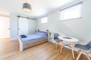 Een bed of bedden in een kamer bij Zilte Hoeve Zoutelande