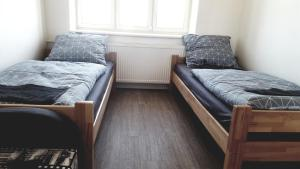 A bed or beds in a room at Apartment Hornický dům