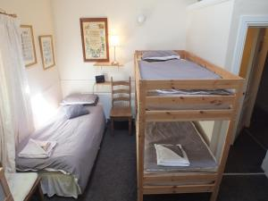 A bed or beds in a room at St Andrews Studio