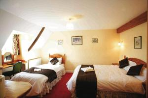 A bed or beds in a room at Malt House