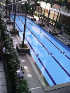 The swimming pool at or close to Fastrooms Bekasi Hotel