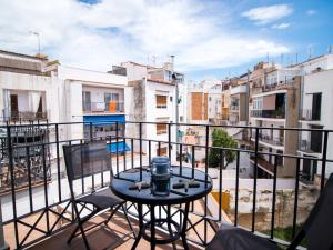 A balcony or terrace at LucasLand Apartments Sitges