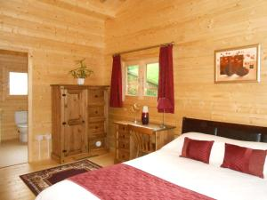A bed or beds in a room at Forest Lodge