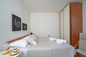 A bed or beds in a room at Torri Centro