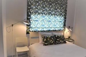 A bed or beds in a room at Braga cosy apartment