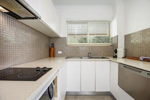 A kitchen or kitchenette at #2 Hastings Street