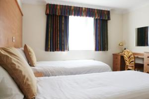 A bed or beds in a room at The Willows Training Centre