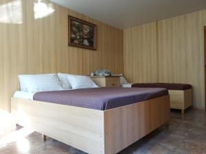 A bed or beds in a room at Inndays on Fr. Engelsa