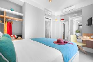 A bed or beds in a room at La Piazzetta Guest House