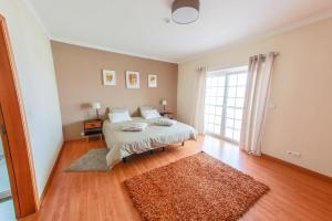 A bed or beds in a room at Liv In Ericeira Guest House