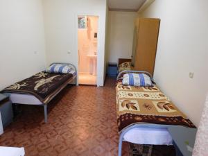 Кровать или кровати в номере Мини-отель на Ивана Голубца