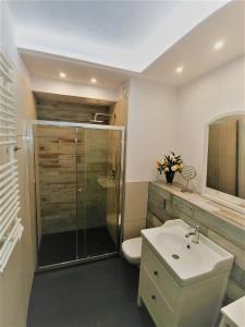 Kúpeľňa v ubytovaní Apartamenty Retmana