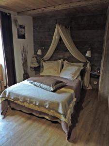 Un ou plusieurs lits dans un hébergement de l'établissement A la Bouge'Hôtes