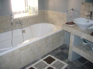 Salle de bains dans l'établissement A la Bouge'Hôtes