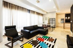 A seating area at Pavilion Residences by GuestReady