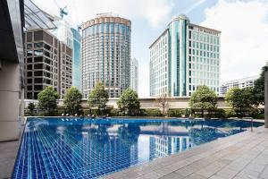 The swimming pool at or near Pavilion Residences by GuestReady