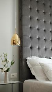 Een bed of bedden in een kamer bij MINT Boutique Studio Apartments I