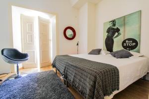 Uma cama ou camas num quarto em Evora Inn