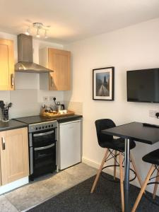 A kitchen or kitchenette at Coleman Studios