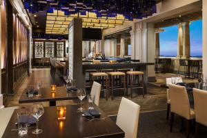 A restaurant or other place to eat at AC Hotel by Marriott Spartanburg