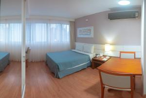 A bed or beds in a room at Salvador Business & Flat