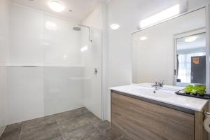 A bathroom at Nightcap at Ferntree Gully Hotel Motel