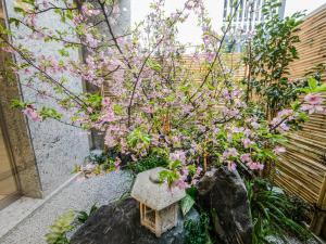 A garden outside HOTEL UNIZO Osaka Shinsaibashi
