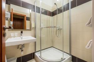 Koupelna v ubytování Hotel Arte