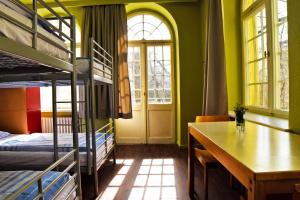A bunk bed or bunk beds in a room at Amstel House Hostel