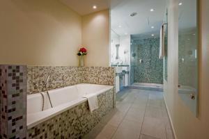 A bathroom at Lindner Hotel AM KU'DAMM Berlin