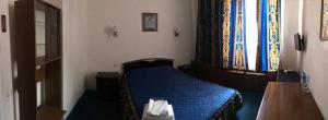 Кровать или кровати в номере Отель East-West