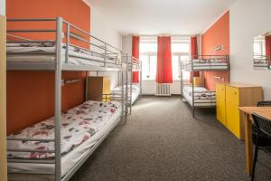 A bunk bed or bunk beds in a room at Hostel Advantage