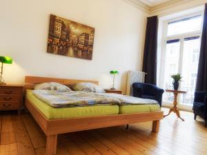 A bed or beds in a room at Pension Bonn Südstadt
