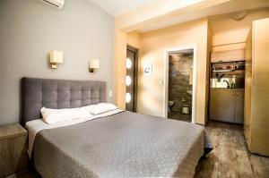 Ένα ή περισσότερα κρεβάτια σε δωμάτιο στο Nefeli