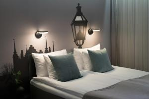 A bed or beds in a room at Hotel C Stockholm