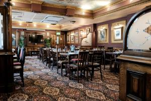 A restaurant or other place to eat at The Mad Hatter Hotel