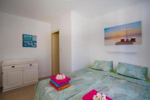 Cama ou camas em um quarto em Villa Cle - Curaçao