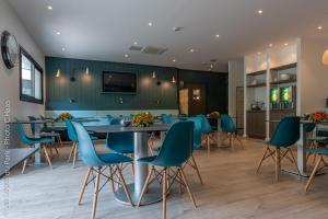 Restaurant ou autre lieu de restauration dans l'établissement Les Loges Du Park - Résidence Hôtelière